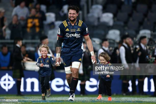 Elliot Dixon of the Highlanders runs out to play his 100th game for the Highlanders during the round 13 Super Rugby match between the Highlanders and...