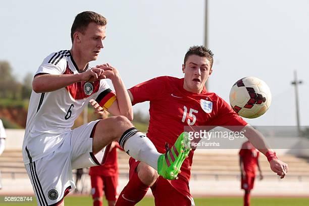 Elliot Embleton of England challenges Jannis Kubler of Germany during the UEFA Under17 match between U17 England v U17 Germany on February 7 2016 in...