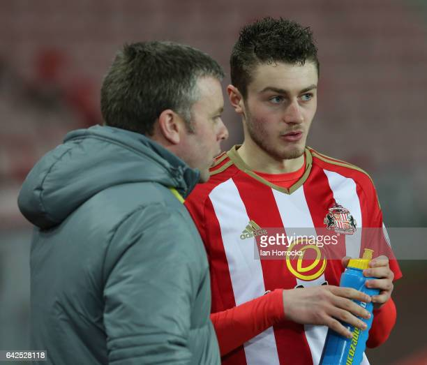 Elliot Embleton of Sunderland chats with his manager Elliott Dickman during the Premier League International Cup Quarter Final match between...