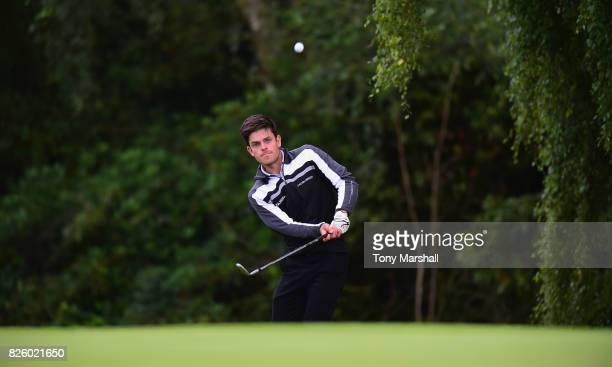 Elliot Groves of Romsey Golf Club chips onto the 18th green during Day Two of the Galvin Green PGA Assistants' Championship at Coxmoor Golf Club on...