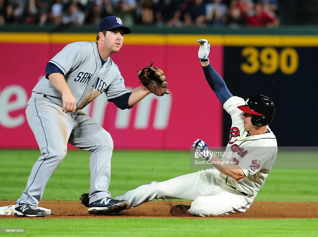 Elliot Johnson #30 of the Atlanta Braves steals second base against Jedd Gyorko #9 of the San Diego Padres at Turner Field on September 14, 2013 in Atlanta, Georgia.