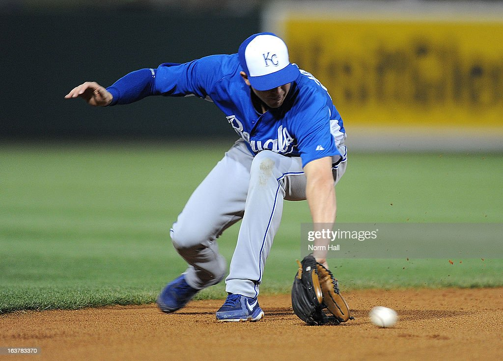 Elliot Johnson #80 of the Kansas City Royals makes a play on a ground ball against the Los Angeles Dodgers on March 15, 2013 in Glendale, Arizona.