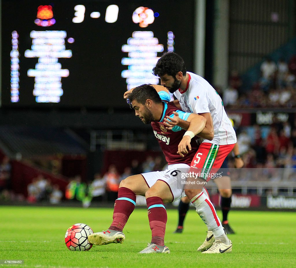 Elliot Lee of West Ham and Peter of FC Lusitans compete for the ball during the UEFA Europa League match between West Ham United and FC Lusitans at Boleyn Ground on July 2, 2015 in London, England.