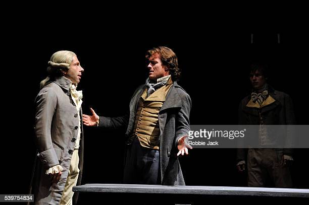 Elliot Levey as Robespierre and Toby Stephens as Georges Danton with Max Bennett as HeraultSechelles in the National Theatre's production of Georg...