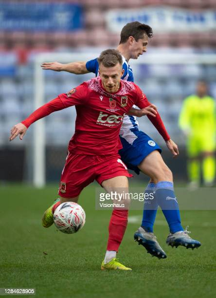 Elliot Newby of Chorley FC and Chris Merrie of Wigan Athletic in action during the FA Cup First Round match between Wigan Athletic and Chorley on...