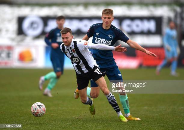 Elliot Newby of Chorley FC is challenged by Max Bardell of Derby County during the FA Cup Third Round match between Chorley and Derby County at...