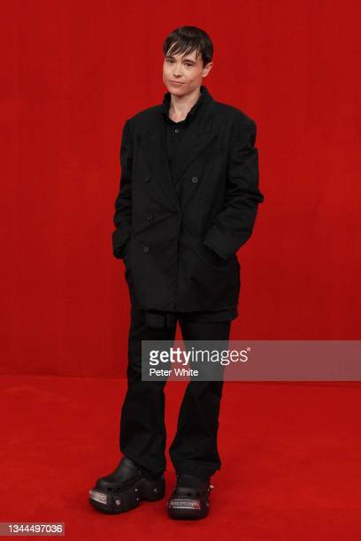 Elliot Page poses on the runway during the Balenciaga Womenswear Spring/Summer 2022 show as part of Paris Fashion Week at Theatre Du Chatelet on...