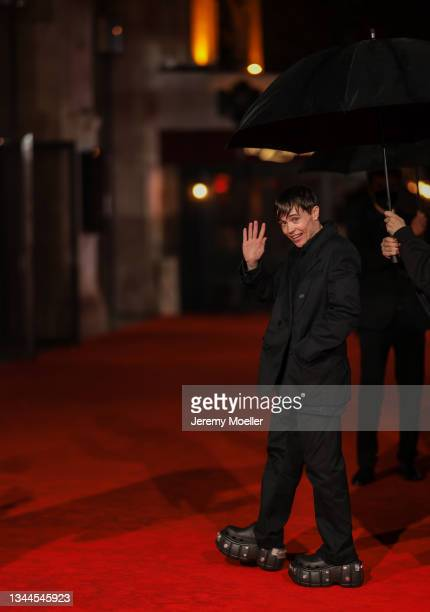 Elliot Page wearing a black jacket and pants and black shoes outside Balenciaga on October 02, 2021 in Paris, France.