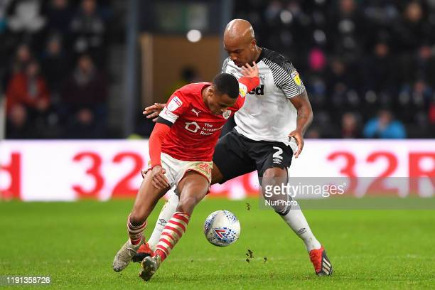 Elliot Simoes of Barnsley holds off Andre Wisdom of Derby County during the Sky Bet Championship match between Derby County and Barnsley at the Pride...