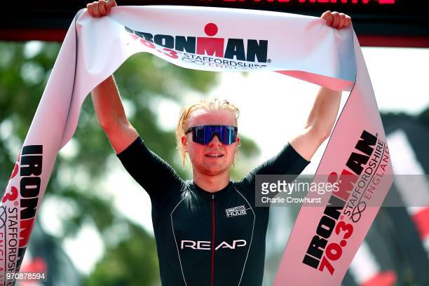 Elliot Smales of Great Britain celebrates as he wins the mens pro race during the IRONMAN 70.3 Staffordshire on June 10, 2018 in Lichfield, England.