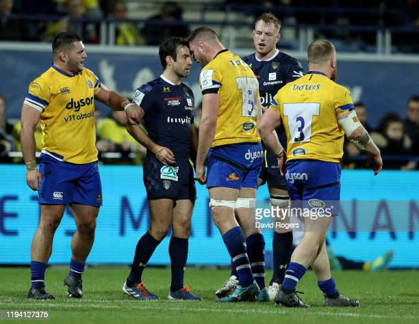 Elliot Stooke of Bath and Morgan Parra put their heads together during the Heineken Champions Cup Round 4 match between ASM Clermont Auvergne and...