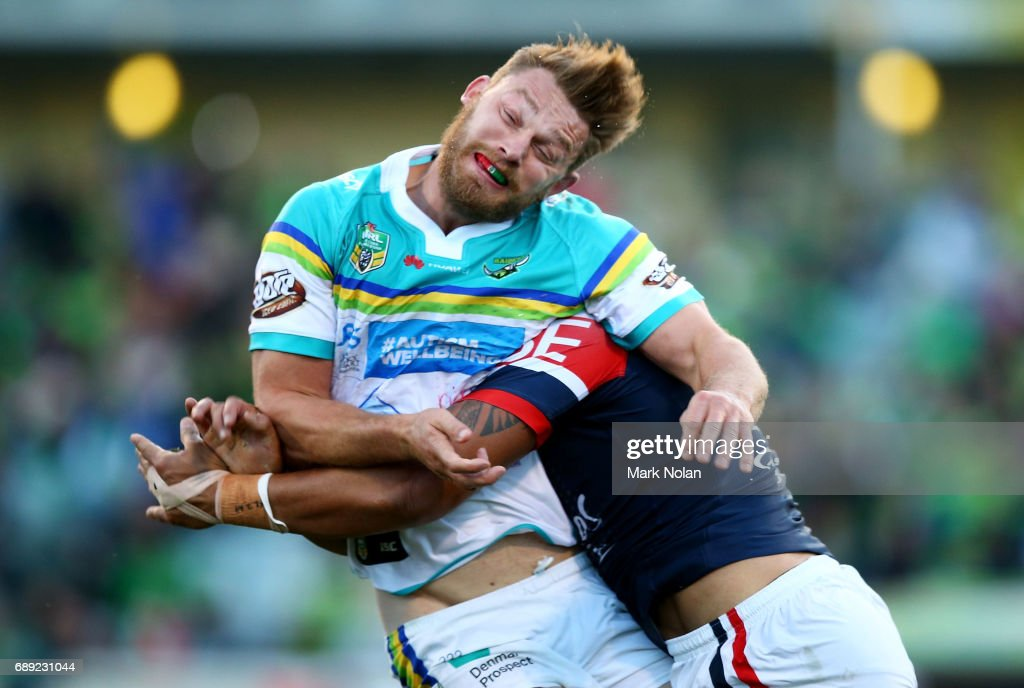 Elliot Whitehead of the Raiders is tackled after offloading during the round 12 NRL match between the Canberra Raiders and the Sydney Roostrers at GIO Stadium on May 28, 2017 in Canberra, Australia.