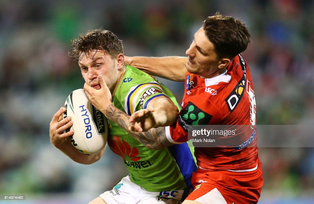 Elliot Whitehead of the Raiders is tackled by Gareth Widdop of the Dragons during the round 19 NRL match between the Canberra Raiders and the St George Illawarra Dragons at GIO Stadium on July 14, 2017 in Canberra, Australia.