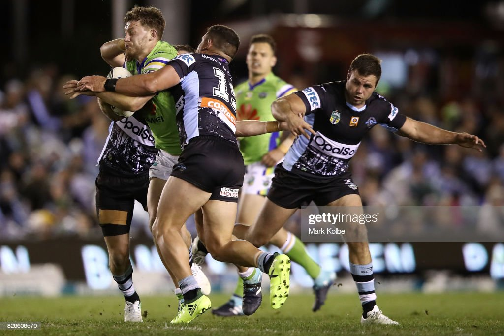 Elliot Whitehead of the Raiders is tackled during the round 22 NRL match between the Cronulla Sharks and the Canberra Raiders at Southern Cross Group Stadium on August 5, 2017 in Sydney, Australia.