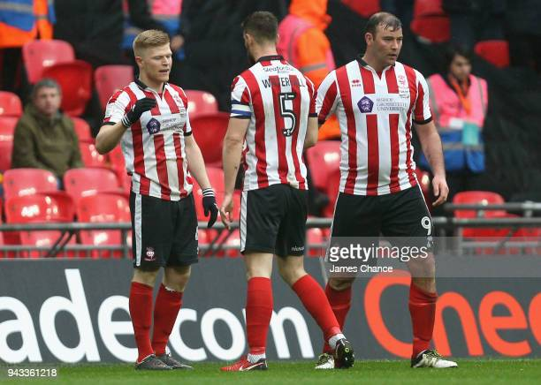 Elliot Whitehouse of Lincoln City celebrates scoring his sides first goal with his team mates during the Checkatrade Trophy Final match between...