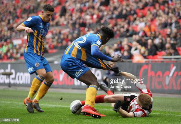Elliot Whitehouse of Lincoln City is fouled by Aristote Nsiala of Shrewsbury Town during the Checkatrade Trophy Final match between Shrewsbury Town...