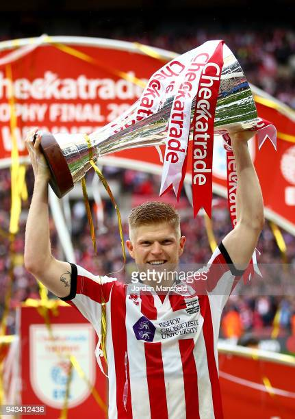Elliot Whitehouse of Lincoln lifts the trophy after victory during the Checkatrade Trophy Final between Shrewsbury Town and Lincoln City at Wembley...