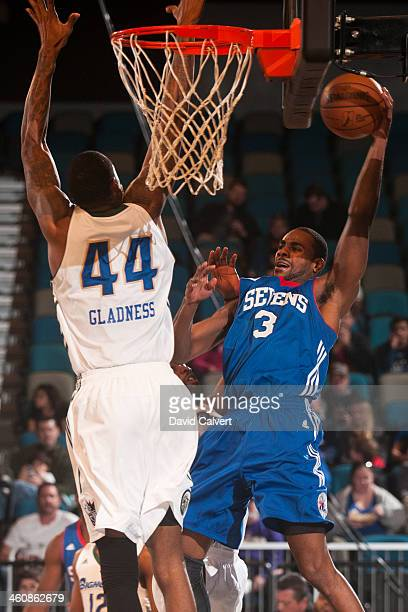 Elliot Williams of the Delaware 87ers looks to pass the ball against Mickell Gladness of the Reno Bighorns during the 2014 NBA D-League Showcase...