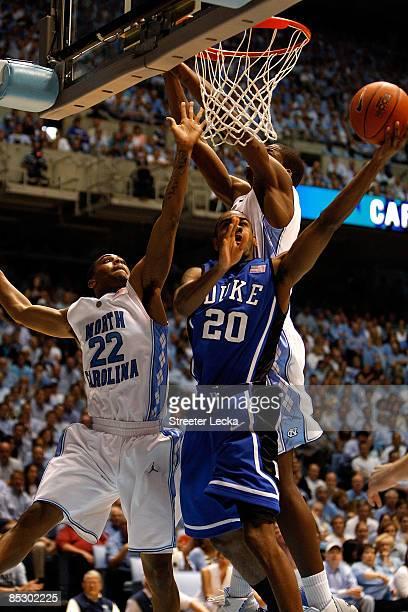 Elliot Williams of the Duke Blue Devils tries to go around teammates Wayne Ellington and Deon Thompson of the North Carolina Tar Heels during their...