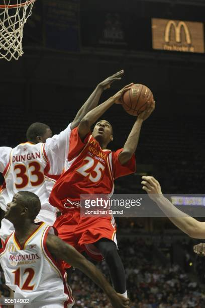 Elliot Williams of the East team goes to the basket against Michael Dunigan of the West team during the 2008 McDonald's All American High School Boys...