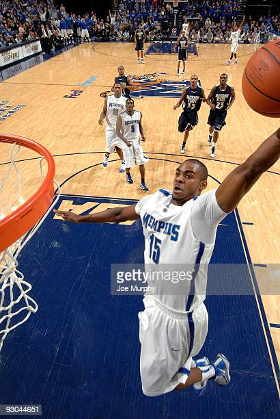 Elliot Williams of the Memphis Tigers goes up for a dunk against the Jackson State Tigers on November 13, 2009 at FedexForum in Memphis, Tennessee.