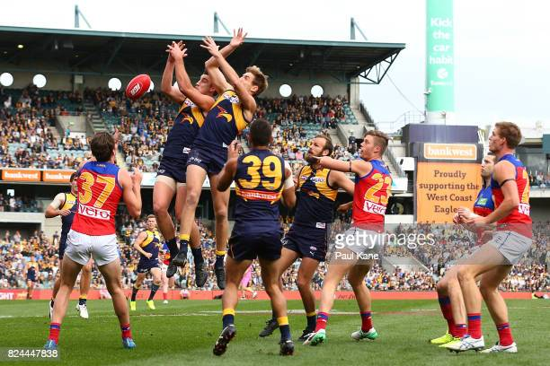 Elliot Yeo and Brad Sheppard of the Eagles contest for a mark during the round 19 AFL match between the West Coast Eagles and the Brisbane Lions at...