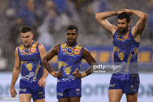 Elliot Yeo, Liam Ryan and Josh J. Kennedy of the Eagles look on after being defeated during the round 17 AFL match between the West Coast Eagles and...