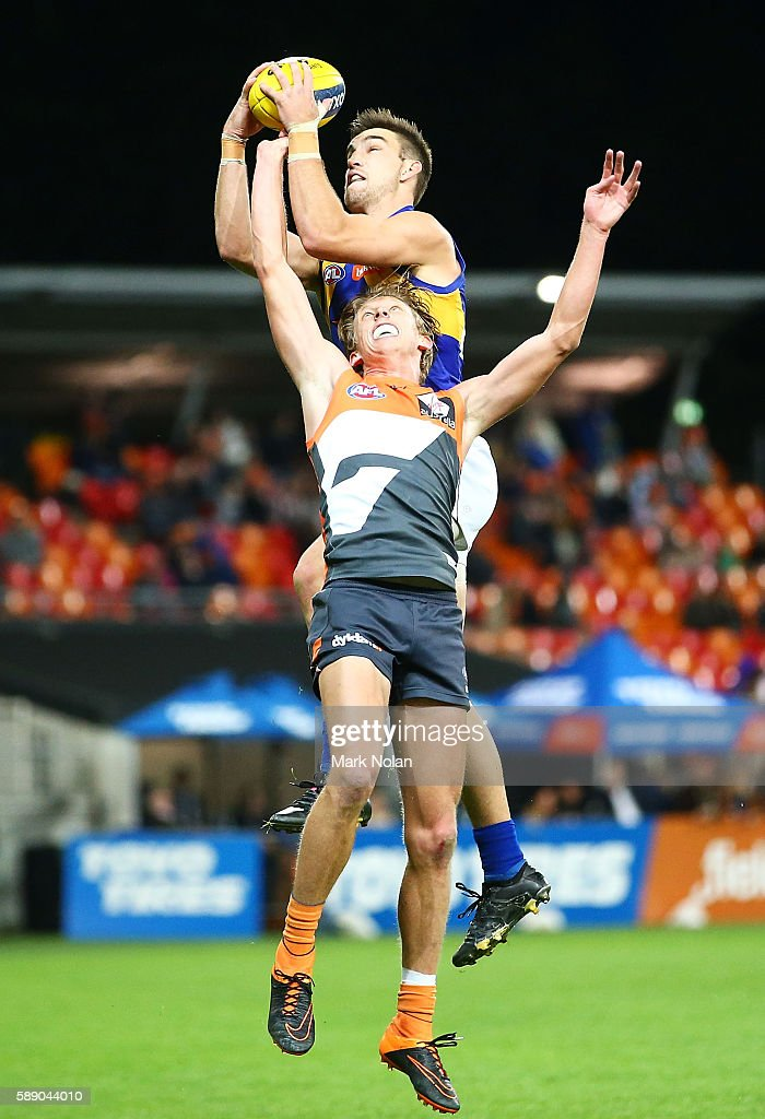 Elliot Yeo of the Eagles and Lachie Whitfield of the Giants contest a mark during the round 21 AFL match between the Greater Western Sydney Giants and the West Coast Eagles at Spotless Stadium on August 13, 2016 in Sydney, Australia.