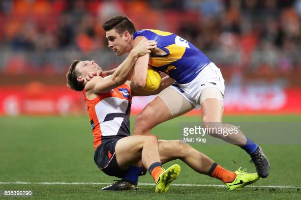 Elliot Yeo of the Eagles is challenged by Toby Greene of the Giants during the round 22 AFL match between the Greater Western Sydney Giants and the...