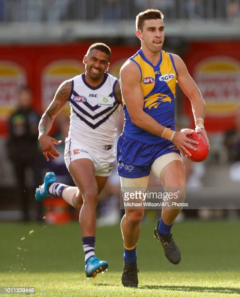 Elliot Yeo of the Eagles is chased by Bradley Hill of the Dockers during the 2018 AFL round 20 match between the West Coast Eagles and the Fremantle...