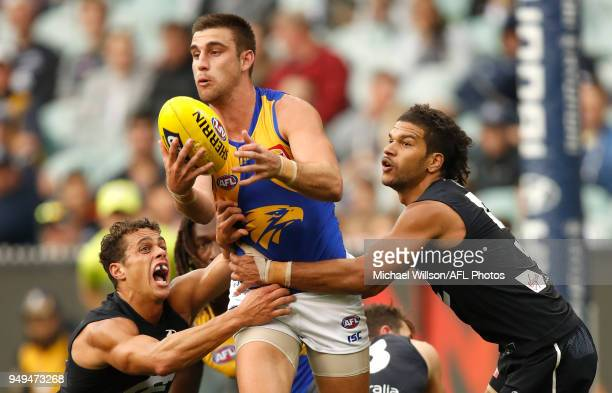 Elliot Yeo of the Eagles is tackled by Ed Curnow and Sam PetrevskiSeton of the Blues during the 2018 AFL round five match between the Carlton Blues...
