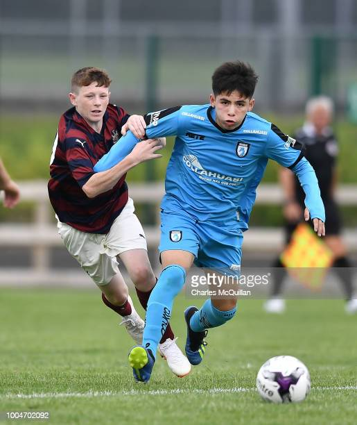 Elliott Anderson of Newcastle United and Bhayron Acevedo of Desportes Iquique during the Super Cup NI football tournament premier section game...