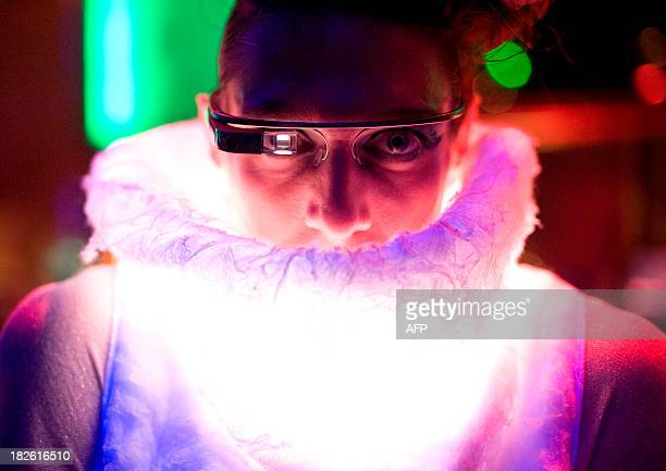 CHAPMAN 'USITINTERNETFASHION' Elliott Gittelsohn takes a picture with Google Glass while wearing a SENSOREE Mood Sweater at the Glazed Conference in...