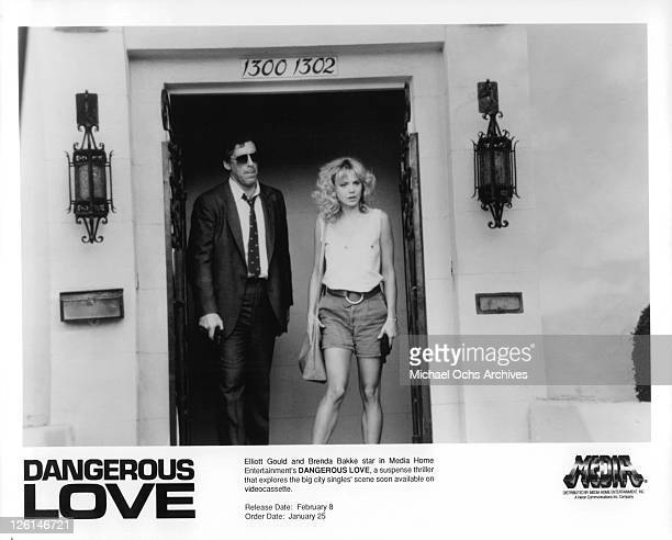 Elliott Gould and Brenda Bakke walk through doorway in a scene from the film 'Dangerous Love' 1988