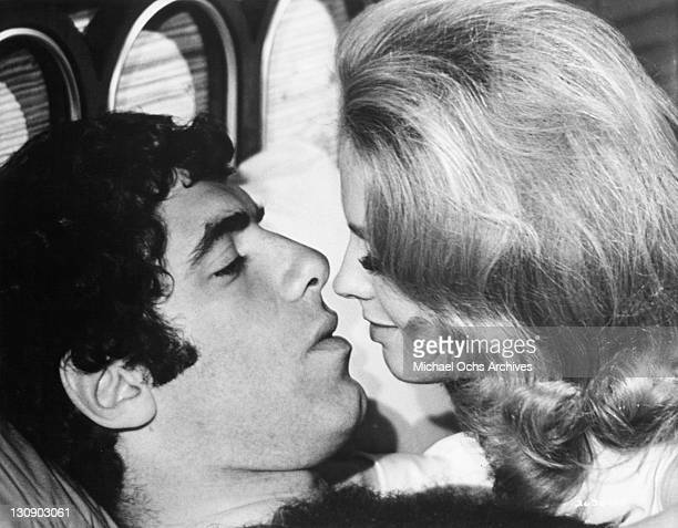Elliott Gould shares a moment with mistress Angel Tompkins in a scene from the film 'I Love My Wife' 1970