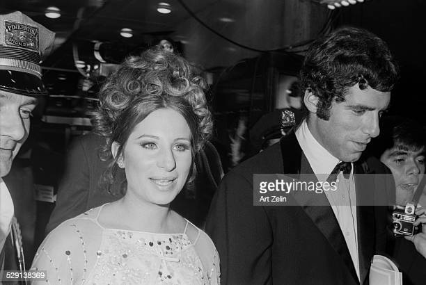 Elliott Gould with Barbra Streisand arriving at a formal event circa 1970 New York