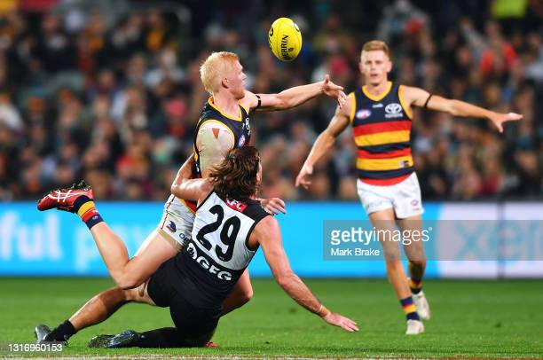 Elliott Himmelberg of the Crows competes with Scott Lycett of Port Adelaide during the round eight AFL match between the Port Adelaide Power and the...