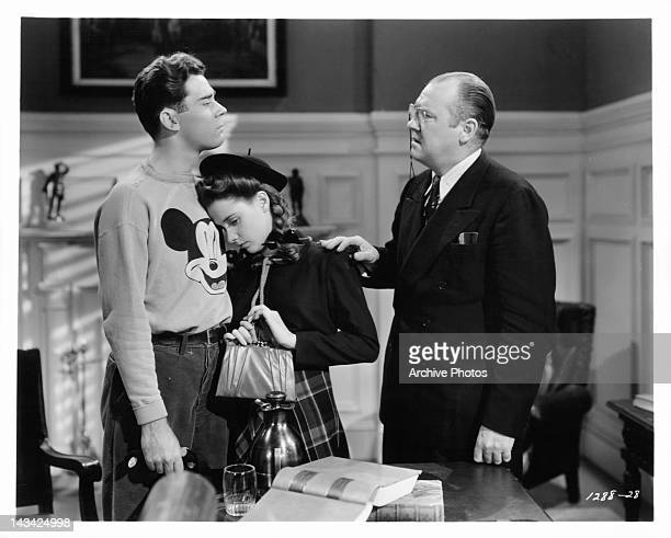 Elliott Reed and Susan Peters report to Emery Parnell after misbehaving in class in a scene from the film 'Young Ideas' 1943
