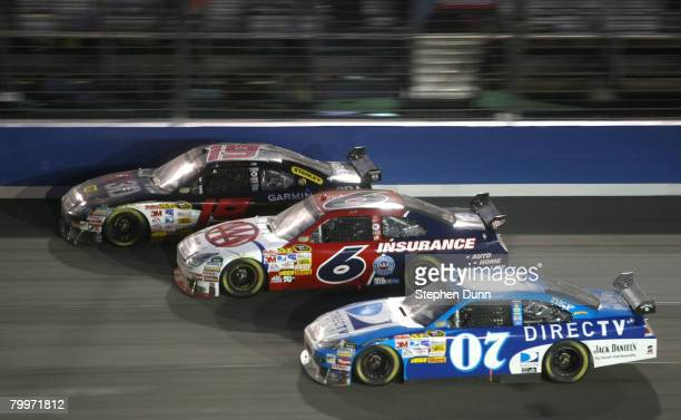 Elliott Sadler, driver of the Best Buy Dodge, races with David Ragan, driver of the AAA/ Southern California Insurance Ford, and Clint Bowyer, driver...