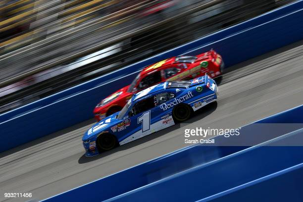 Elliott Sadler driver of the Cessna Chevrolet leads Ross Chastain driver of the Daley Technology Systems Chevrolet during the NASCAR Xfinity Series...
