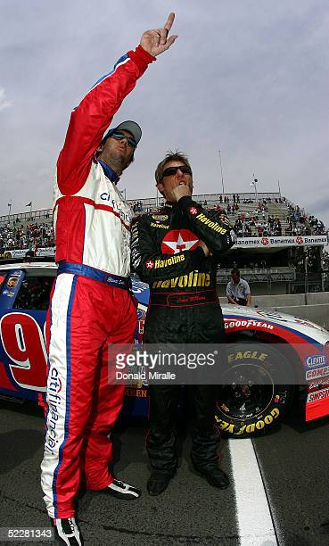 Elliott Sadler, driver of the Citi Financial Ford Taurus and Jamie McMurray, driver of the Havoline Dodge Intrepid, look on during qualifying for the...
