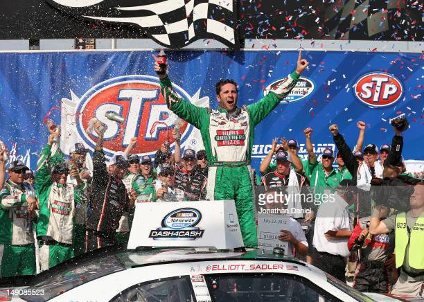 Elliott Sadler driver of the Hunt Brothers Pizza Chevrolet celebrates winning the NASCAR Nationwide Series STP 300 at Chicagoland Speedway on July 22...