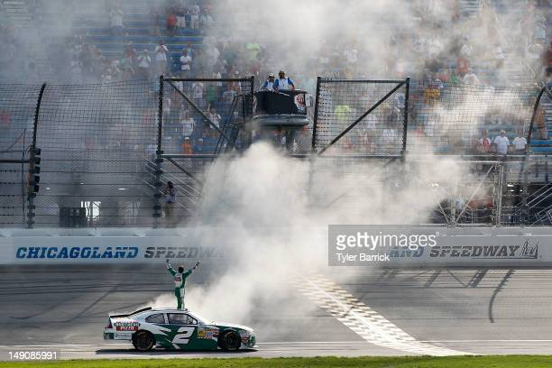Elliott Sadler driver of the Hunt Brothers Pizza Chevrolet celebrates with a burnout after winning the NASCAR Nationwide Series STP 300 at...