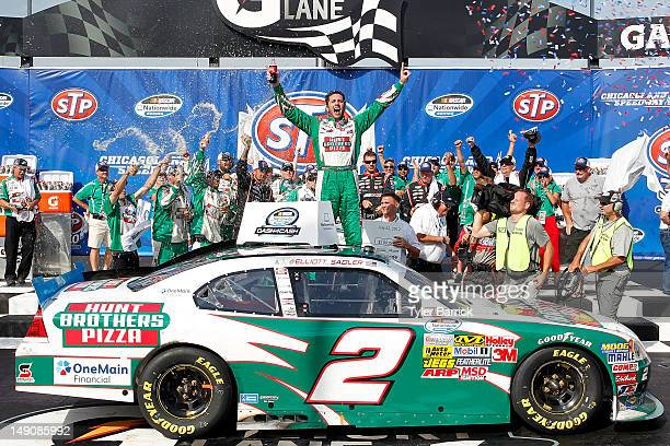 Elliott Sadler driver of the Hunt Brothers Pizza Chevrolet celebrates in Victory Lane after winning the NASCAR Nationwide Series STP 300 at...