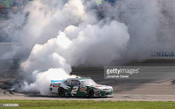 Elliott Sadler driver of the Hunt Brothers Pizza Chevrolet does a burnout after winning the NASCAR Nationwide Series STP 300 at Chicagoland Speedway...