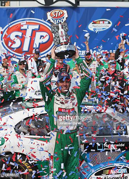 Elliott Sadler driver of the Hunt Brothers Pizza Chevrolet holds the trophy after winning the NASCAR Nationwide Series STP 300 at Chicagoland...