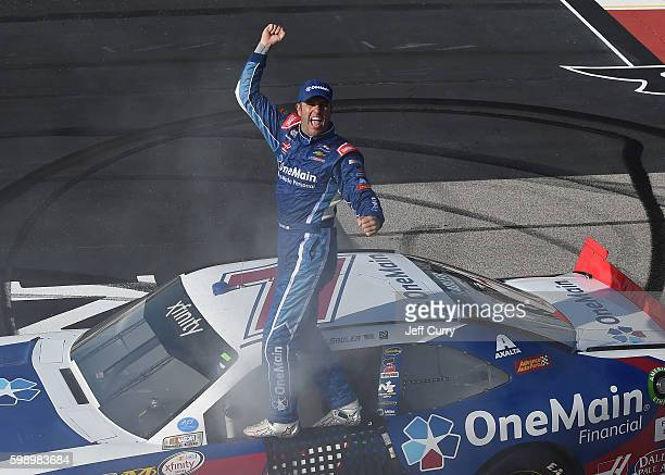 Elliott Sadler driver of the OneMain Chevrolet celebrates after winning the NASCAR XFINITY Series VFW Sport Clips Help a Hero 200 at Darlington...