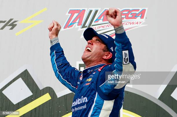 Elliott Sadler driver of the OneMain Chevrolet celebrates in Victory Lane after winning the NASCAR XFINITY Series Sparks Energy 300 at Talladega...