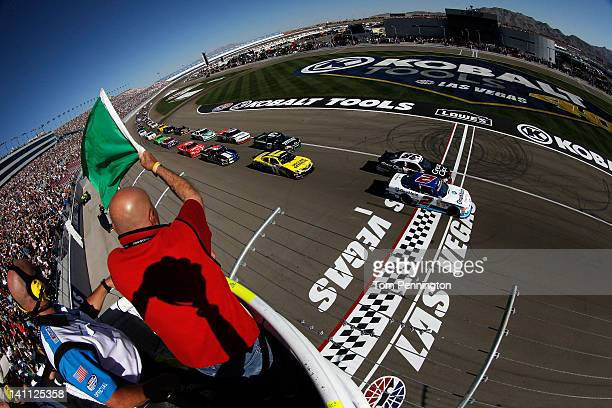 Elliott Sadler driver of the OneMain Financial Chevrolet and Kasey Kahne driver of the Great Clips Chevrolet lead the field to the green flag to...