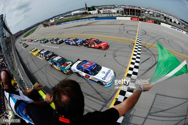 Elliott Sadler driver of the OneMain Financial Chevrolet and Ricky Stenhouse Jr driver of the Blackwell Angus Beef/Cargill Ford lead the field past...